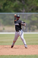 Miami Marlins Samuel Castro (10) throws to first base during a minor league Spring Training game against the New York Mets on March 26, 2017 at the Roger Dean Stadium Complex in Jupiter, Florida.  (Mike Janes/Four Seam Images)