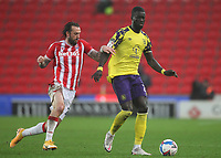 Huddersfield Town's Mouhamadou Naby Sarr in action with  Stoke City's Steven Fletcher<br /> <br /> Photographer Mick Walker/CameraSport<br /> <br /> The EFL Sky Bet Championship - Stoke City v HUddersfield Town - Saturday 21st November 2020 - bet365 Stadium - Stoke<br /> <br /> World Copyright © 2020 CameraSport. All rights reserved. 43 Linden Ave. Countesthorpe. Leicester. England. LE8 5PG - Tel: +44 (0) 116 277 4147 - admin@camerasport.com - www.camerasport.com
