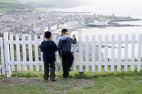 Two Hasidic boys look out over Aberystwyth from Constitutional Hill.