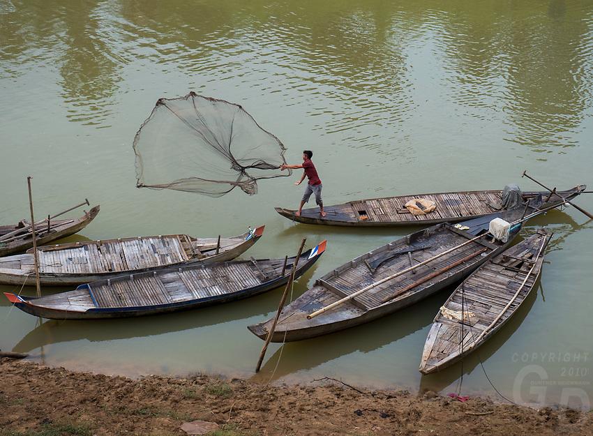 Casting the net at a small waterway close to the Tonle Sap Lake near Battambang, Cambodia