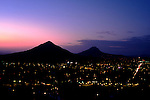 Photo taken at midnight from hilltop overlooking San Luis Obispo, California on the Central Coast includes two of the famous 'Nine Morros'.