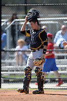 Pittsburgh Pirates catcher Reese McGuire (7) during a minor league spring training game against the Philadelphia Phillies on March 18, 2014 at the Carpenter Complex in Clearwater, Florida.  (Mike Janes/Four Seam Images)