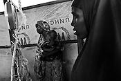 Women queue to weigh their malnutritioned children inside a registration centre in IFO-1camp in the Dadaab refugee camp in northeastern Kenya. Photo: Sanjit Das/Panos