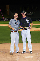 Salt River Rafters Ryan McMahon (25), of the Colorado Rockies organization, is presented with the National League first place trophy bat from Zinger by Josh Michalsen after the Bowman Hitting Challenge on October 8, 2016 at the Salt River Fields at Talking Stick in Scottsdale, Arizona.  (Mike Janes/Four Seam Images)