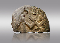 Picture & image of Hittite monumental relief sculpted orthostat stone panel of Water Gate. Basalt, 900 - 700 BC. Anatolian Civilisations Museum. Ankara. Turkey.<br /> <br /> Fragment of Two bull men holding the trunk of the tree in the middle. The faces of the figures, having tufts in both temples over the chain, have been depicted from the front direction. The horned figures with bull like ears and legs have human bodies.<br /> <br /> On a gray background.