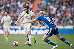 Nacho Fernandez (c) of Real Madrid is challenged by Gaizka Toquero Pinedo (r) of Deportivo Alaves during their La Liga match between Real Madrid and Deportivo Alaves at the Santiago Bernabeu Stadium on 02 April 2017 in Madrid, Spain. Photo by Diego Gonzalez Souto / Power Sport Images