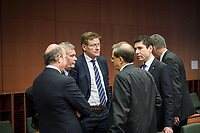 Belgian finance minister Johan Van Overtveldt (C) talks with other ministers  at the start of a Eurogroup with European Finance Ministers meeting at EU council headquarters in Brussels, Belgium on 26.01.2015 The Eurogroup's meeting focus on Greece, after  leftist anti-bailout party SYRIZA won parliamentary elections by Wiktor Dabkowski
