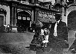 """St Louis MO:  View of """"The Streets of Seville"""" exhibit at the Louisiana Purchase Exposition.  The exhibit was sponsored by the country of Spain and included """"The Girl from Madrid"""" in the background."""
