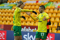 13th February 2021; Carrow Road, Norwich, Norfolk, England, English Football League Championship Football, Norwich versus Stoke City; Emi Buendia of Norwich City celebrates his goal with Todd Cantwell for 3-1 in the 64th minute