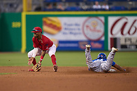 Clearwater Threshers shortstop Luis García (5) fields a pickoff attempt throw as Leo Jimenez (8) steals second during a game against the Dunedin Blue Jays on May 19, 2021 at BayCare Ballpark in Clearwater, Florida. (Mike Janes/Four Seam Images)