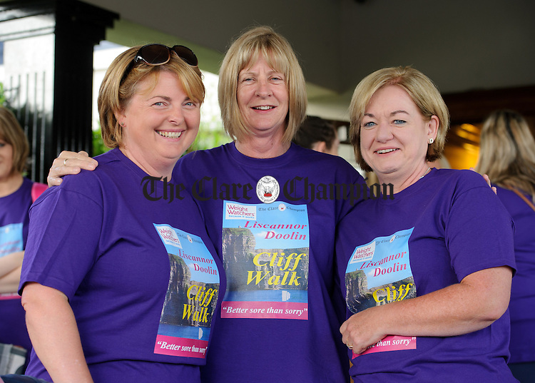 Mary Barry, Eileen O Doherty and Sharon King about to catch the bus for the Weightwatchers/Clare Champion Liscannor to Cliffs of Moher coastal walk. Photograph by John Kelly.