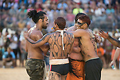 Kuikuro and Maori contestants congratulate each other and embrace in friendship after a tug of war at the International Indigenous Games, in the city of Palmas, Tocantins State, Brazil. The Brazilian Kuikuro won the bout. Photo © Sue Cunningham, pictures@scphotographic.com 25th October 2015