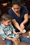 3 year old boy and mother playing with blocks, talking, learning the alphabet, mother pointing out letter