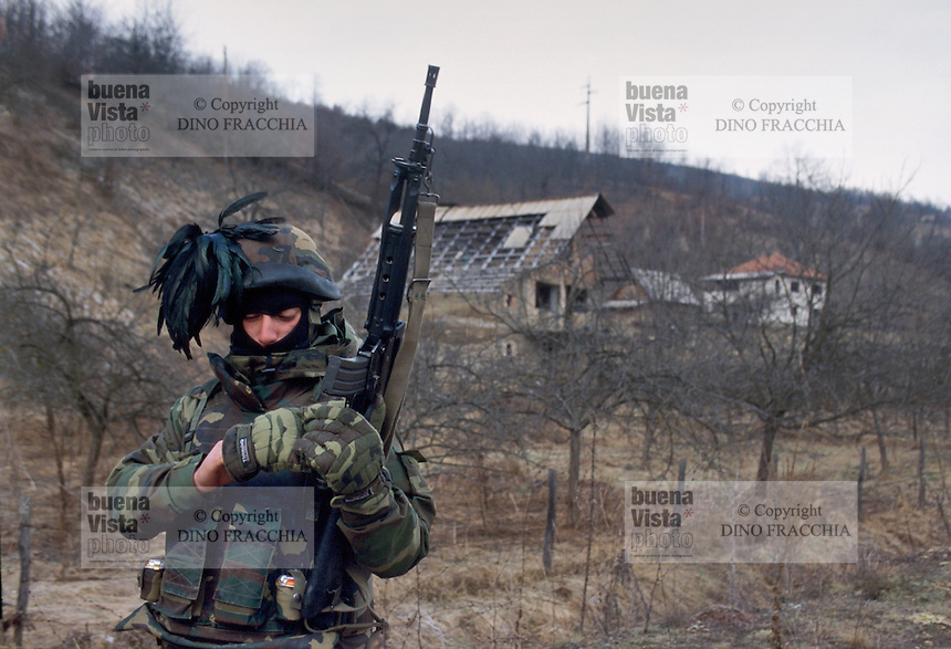 - NATO intervention in Bosnia-Herzegovina, Italian soldiers on patrol in a Serbian village....- intervento NATO in Bosnia-Herzegovina, militari italiani di pattuglia in un villaggio serbo
