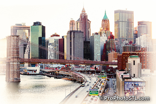 The Brooklyn Bridge is a hybrid cable-stayed/suspension bridge in New York City and is one of the oldest bridges of either type in the United States. Completed in 1883, it connects the boroughs of Manhattan and Brooklyn by spanning the East River.