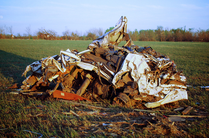 A destroyed automobile lays crumpled in a field northeast of the Golden Spur Mobile home park in Andover Kansas after the passage of an F-5 killer tornado on April 26th, 1991. Many residents lost their lives here when the town's one and only warning siren failed.