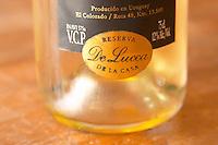A bottle of chardonnay with a gold colour stick on label saying Reserva de la Casa - house reserve - De Lucca. Bodega De Lucca Winery, El Colorado, Progreso, Uruguay, South America