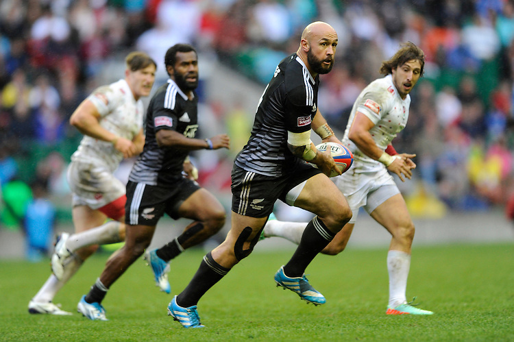 D J Forbes of New Zealand passes during Day Two of the iRB Marriott London Sevens at Twickenham on Sunday 11th May 2014 (Photo by Rob Munro)