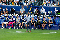 CARSON, CA - JUNE 19: Los Angeles Galaxy manager Greg Vanney managing his team with his bench behind him during a game between Seattle Sounders FC and Los Angeles Galaxy at Dignity Health Sports Park on June 19, 2021 in Carson, California.