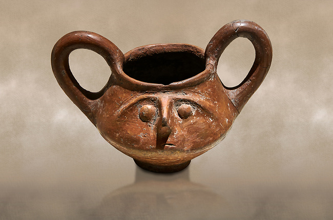 Hittite terra cotta double handled jug with a relief human face- 17th - 16th century BC - Hattusa ( Bogazkoy ) - Museum of Anatolian Civilisations, Ankara, Turkey