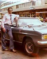BNPS.co.uk (01202) 558833. <br /> Pic: AndrewLast/BNPS<br /> <br /> Pictured: Fred with the Capri in the 1970s. <br /> <br /> Pensioner Fred Last has bought back his beloved Ford Capri more than 20 years after he sold it.<br /> <br /> Fred, 92, bought the Mark One Capri from new in 1971 and it was his pride and joy for almost three decades.<br /> <br /> He regularly used the vehicle for family holidays and day trips before selling it in 1999, once his children had grown up.