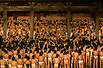 The Naked Man Festival, held on a winter evening in Okoyama, Japan, features five thousand men in loincloths vying for a symbolic baton, which is tossed into the inebriated throng. Whoever ultimately possesses the baton receives good luck for the year. The scrum becomes tumultuous when one man catches the baton because anyone who touches him acquires the good luck as well.
