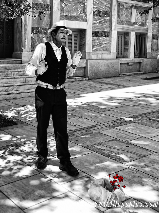 A mime performs in the street of Athens, Greece