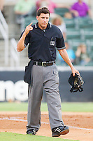 Home plate umpire Derek Mollica indicates there is one warm up pitch left between innings of the South Atlantic League game between the Hickory Crawdads and the Kannapolis Intimidators at Fieldcrest Cannon Stadium August 18, 2010, in Kannapolis, North Carolina.  Photo by Brian Westerholt / Four Seam Images