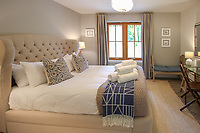 BNPS.co.uk (01202) 558833. <br /> Pic: Bidwells/BNPS<br /> <br /> Pictured: Bedroom.<br /> <br /> Better than a gravy boat...<br /> <br /> A striking country house built by a bishop as a wedding gift for his son is on the market for offers over £2m.<br /> <br /> Dunbeg House sits in an incredible position on the bank of a loch with stunning panoramic water and mountain views.<br /> <br /> The impressive property not only includes the five-bedroom main house, but also a two-bedroom cottage that has been run as a successful holiday let and over four acres of woodland garden.