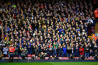 Sunday, 23 February 2014<br /> Pictured: Swansea City fans applaud the memory of Sir Tom Finney<br /> Re: Barclay's Premier League, Liverpool FC v Swansea City FC v at Anfield Stadium, Liverpool Merseyside, UK.