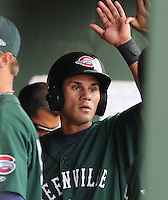 Center fielder Reymond Fuentes (31) of the Greenville Drive is congratulated in the dugout after scoring in the first inning in a game against the West Virginia Power on May 2, 2010, at Fluor Field at the West End in Greenville, S.C. Photo by: Tom Priddy/Four Seam Images