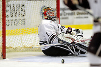 3 January 2009: Colgate Raiders' goaltender Alex Evin, a Freshman from Castlegar, B.C., gives up a first period goal to the Ferris State Bulldogs during the consolation game of the 2009 Catamount Cup Ice Hockey Tournament hosted by the University of Vermont at Gutterson Fieldhouse in Burlington, Vermont. The two teams battled to a 3-3 draw, with the Bulldogs winning a post-game shootout 2-1, thus placing them third in the tournament...Mandatory Photo Credit: Ed Wolfstein Photo