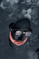 Titus Kodzoman from England about to dive during freediving competition Oslo Ice Challenge at freshwater lake Lutvann, outside the Norwegian capital Oslo. Atheletes, including current and former world champions, entered a hole in the ice to compete. The participants reached depths down to 52 meters below the surface.