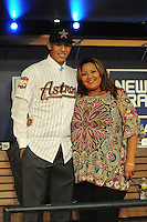 Shortstop Carlos Correa (Puerto Rico Baseball Academy) the number one overall pick to the Houston Astros with mom during the MLB Draft on Monday June 04,2012 at Studio 42 in Secaucus, NJ.  Photo By Tomasso DeRosa/ Four Seam Images