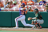 Catcher Spencer Kieboom #22 swings at a pitch during a  game against the Miami Hurricanes at Doug Kingsmore Stadium on March 31, 2012 in Clemson, South Carolina. The Tigers won the game 3-1. (Tony Farlow/Four Seam Images)..