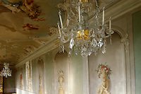 The ceiling of this salon is covered in frescoes by Carlo Zucchi and Francesco Martini and the walls are lined with hand-painted urns in trompe l'oeil niches
