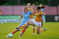 Allie Long (10) of Sky Blue FC is defended by Cat Whitehill (4) of the Atlanta Beat. Sky Blue FC defeated the Atlanta Beat 3-0 during a Women's Professional Soccer (WPS) match at Yurcak Field in Piscataway, NJ, on May 21, 2011.