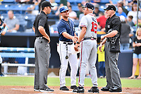First base umpire Emil Jimenez, Asheville Tourists manager Warren Schaeffer (13), Rome Braves manager Randy Ingle (12) and home plate umpire Mike Snover greet each other before a game between the Rome Braves and the Asheville Tourists at McCormick Field on July 27, 2017 in Asheville, North Carolina. The Braves defeated the Tourists 6-3. (Tony Farlow/Four Seam Images)
