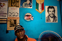A Cuban watchmaker works in front of a wall covered by pictures of the revolutionary leaders in Havana, Cuba, 16 August 2008. During the Cuban Revolution, an armed rebellion at the end of the 1950s in Cuba, most of the revolutionary leaders started as no-name soldiers fighting in the jungle. Although the revolutionary leaders, after taking over the power, became autocratic rulers holding almost absolute power and putting the opposition in jail, for some reason Cuban people have never stopped to worship Fidel Castro, Che Guevara, Raul Castro and others. Cubans hang their photos and portraits on the wall in homes, shops and working places even they don't have to. The people of Cuba love their heroes.