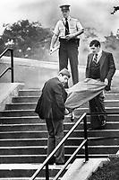 1978 File -<br /> <br /> Body of murder victim Shirley Hauser is taken from school yard<br /> <br /> Photo : Boris Spremo - Toronto Star archives - AQP