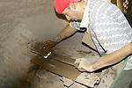 MAN IN UNDERGROUND KILN WORKS to HARDEN TOOLS