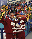 brothers robin and brian mckeever express their joy after winning the gold medal at the 5km classic race at the paralympics in salt lake city this morning.