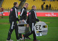 Officials carry the replacement notification numbers off after the ITM Cup rugby union match between Wellington Lions and Waikato at Westpac Stadium, Wellington, New Zealand on Saturday, 16 August 2014. Photo: Dave Lintott / lintottphoto.co.nz