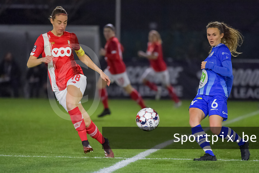 Standard midfielder Charlotte Cranshoff (18) and Gent's midfielder Emma Van Britsom (6) pictured during a female soccer game between  AA Gent Ladies and Standard Femina de Liege on the 8 th matchday of the 2020 - 2021 season of Belgian Scooore Womens Super League , friday 20 th of November 2020  in Oostakker , Belgium . PHOTO SPORTPIX.BE | SPP | STIJN AUDOOREN