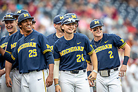 Michigan Wolverines catcher Casey Buckley (24) before Game 6 of the NCAA College World Series against the Florida State Seminoles on June 17, 2019 at TD Ameritrade Park in Omaha, Nebraska. Michigan defeated Florida State 2-0. (Andrew Woolley/Four Seam Images)