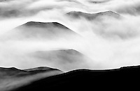 Clouds settle around cinder cones including Pu'u O Maui, the tallest cinder cone in Haleakala National Park, Maui.