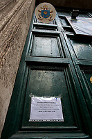 """Church: open (but mass and events are not allowed). <br /> <br /> Via del Corso.<br /> <br /> Rome, 12/03/2020. Documenting Rome under the Italian Government lockdown for the Outbreak of the Coronavirus (SARS-CoV-2 - COVID-19) in Italy. On the evening of the 11 March 2020, the Italian Prime Minister, Giuseppe Conte, signed the March 11th Decree Law """"Step 4 Consolidation of 1 single Protection Zone for the entire national territory"""" (1.). The further urgent measures were taken """"in order to counter and contain the spread of the COVID-19 virus"""" on the same day when the WHO (World Health Organization, OMS in Italian) declared the coronavirus COVID-19 as a pandemic (2.).<br /> ISTAT (Italian Institute of Statistics) estimates that in Italy there are 50,724 homeless people. In Rome, around 20,000 people in fragile condition have asked for support. Moreover, there are 40,000 people who live in a state of housing emergency in Rome's municipality.<br /> March 11th Decree Law (1.): «[…] Retail commercial activities are suspended, with the exception of the food and basic necessities activities […] Newsagents, tobacconists, pharmacies and parapharmacies remain open. In any case, the interpersonal safety distance of one meter must be guaranteed. The activities of catering services (including bars, pubs, restaurants, ice cream shops, patisseries) are suspended […] Banking, financial and insurance services as well as the agricultural, livestock and agri-food processing sector, including the supply chains that supply goods and services, are guaranteed, […] The President of the Region can arrange the programming of the service provided by local public transport companies […]».<br /> Updates: on the 12.03.20 (6:00PM) in Italy there 14.955 positive cases; 1,439 patients have recovered; 1,266 died.<br /> <br /> Footnotes & Links:<br /> Info about COVID-19 in Italy: http://bit.do/fzRVu (ITA) - http://bit.do/fzRV5 (ENG)<br /> 1. March 11th Decree Law http://bit.do/fzREX (ITA) - http://bi"""