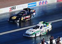 Apr. 1, 2011; Las Vegas, NV, USA: NHRA funny car driver Mike Neff (near) races alongside Brian Thiel during qualifying for the Summitracing.com Nationals at The Strip in Las Vegas. Mandatory Credit: Mark J. Rebilas-