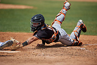 Jupiter Hammerheads catcher B.J. Lopez (18) attempts to tag Ryan Noda sliding into home to score the game winning run during a Florida State League game against the Dunedin Blue Jays on May 16, 2019 at Jack Russell Memorial Stadium in Clearwater, Florida.  Dunedin defeated Jupiter 1-0.  (Mike Janes/Four Seam Images)