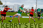 Seimi Ó Fuarain, Ballyheigue, in action against Jack Enright, Ballyduff, during the Kerry County Minor Hurling Championship Final match between Ballyduff and Ballyheigue at Austin Stack Park in Tralee, Kerry.